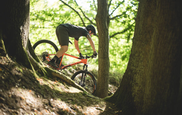 Man riding a saracen mantra trail downhill